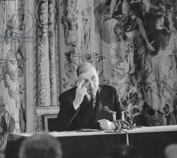 rench president Charles de Gaulle during a press conference at the Elysee, Paris, March 25, 1959 (b/w photo)