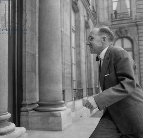 French Industry minister Jean-Marcel Jeanneney arriving at the Elysee, Paris, to attend the council of ministers, August 24, 1960 (b/w photo)
