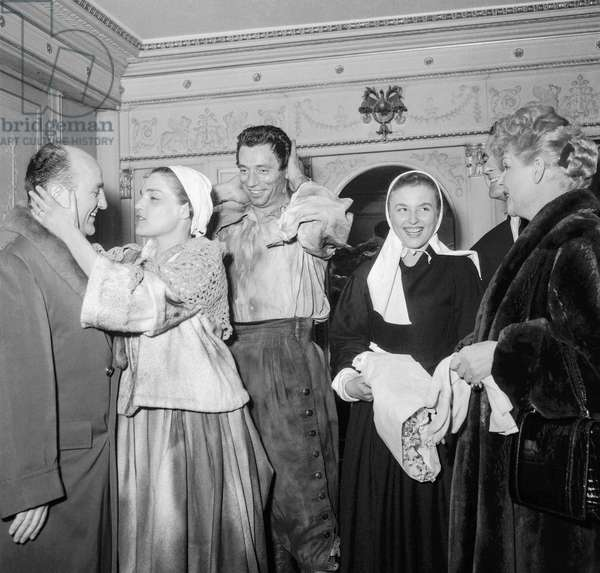 "Bernard Blier, Simone Signoret, Yves Montand, Nicole Courcel and Elvire Popesco after last rehearsal of play ""The Crucible"" at the Theatre Sarah-Bernhardt in Paris on December 14, 1954 (b/w photo)"