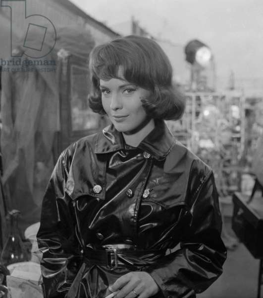 """Actress Jean Seberg on set of film """"L'amant de cinq jours"""" at the flea market in Saint Ouen near Paris, October 17, 1960 (b/w photo)"""