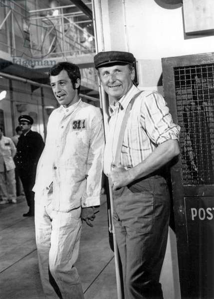 """Jean Paul Belmondo and Bourvil on the set of the movie """"Le cerveau"""" (The Brain)  at the Saint Maurice studio in 1968 (b/w photo)"""