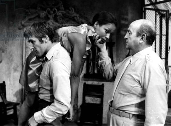 French actors Gerard Depardieu and Bernard Blier with French presenter Sylvette Cabrisseau in play 'Galapagos' in Theatre de la Madeleine in Paris, September 1971 (b/w photo)