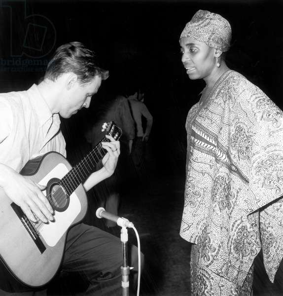 South-African Singer Miriam Makeba and her Guitarist during Rehearsals at Olympia in Paris May 13, 1964 (b/w photo)