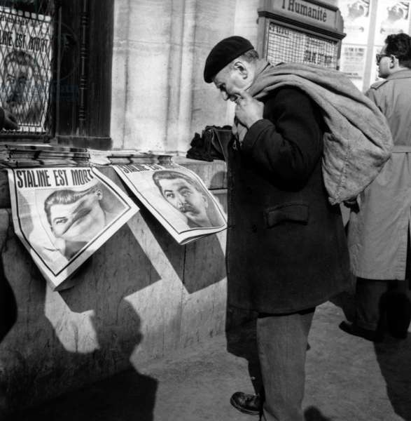 Old Worker Learning The Death of Stalin in The Newspapers in Paris March 6, 1953 (b/w photo)