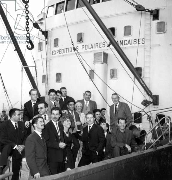 "Departure in The Havre of French Polar Expedition on Danish Cargo ""Thala Dan"" For Adelie Land. here French Explorer Paul Emile Victor and his Team on October 12, 1963 (b/w photo)"