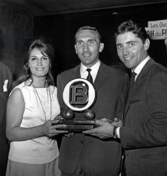 French Singers Dalida and Sacha Distel Giving A Prize To Footballerandre Lerond, June 8, 1962 (b/w photo)
