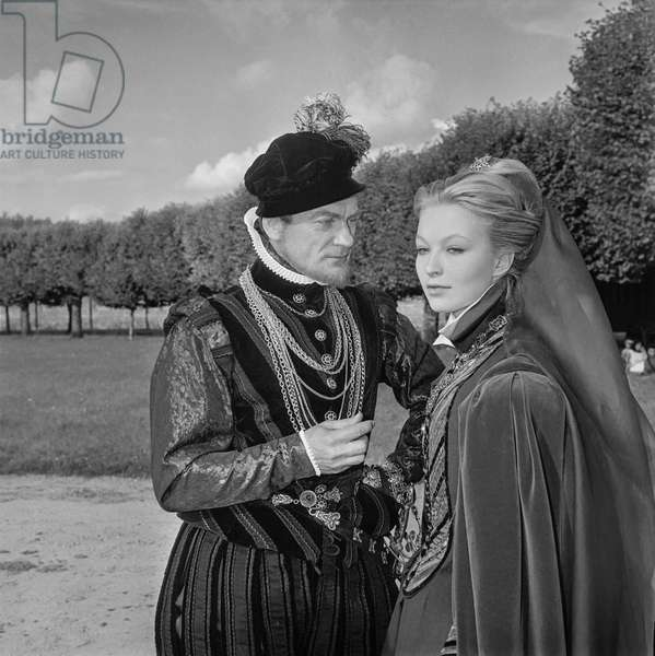 "French actors Jean Marais and Marina Vlady on set of film ""Le Prince de Cleves"" at Chambord castle, France, August 11, 1960 (b/w photo)"