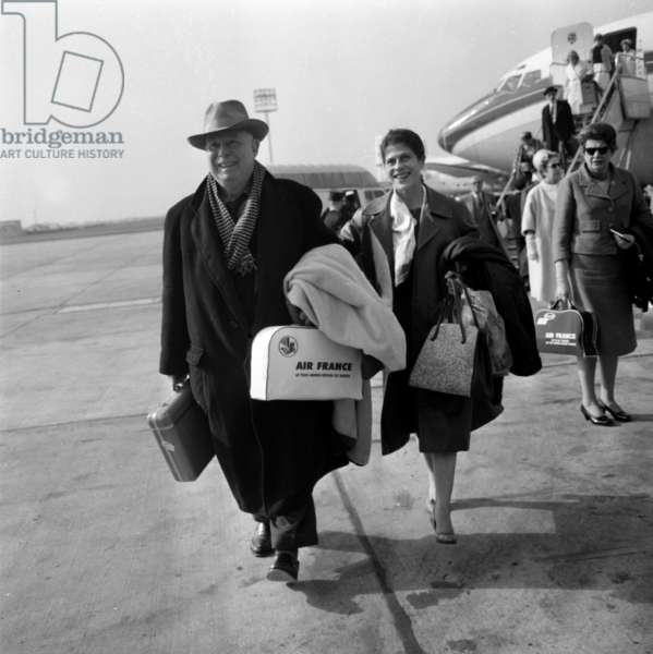 Jean Renoir and his Wife at Orly Airport, in Order To Present The Film 'Experiment in Evil', May 17, 1961 (b/w photo)