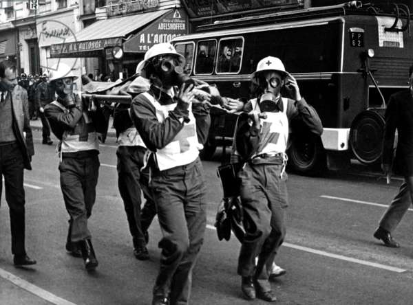 Members of Red Cross With Gas Mask and Helmet, Carrying A Wounded Demonstrator on A Stretcher June 12, 1968, Paris (b/w photo)