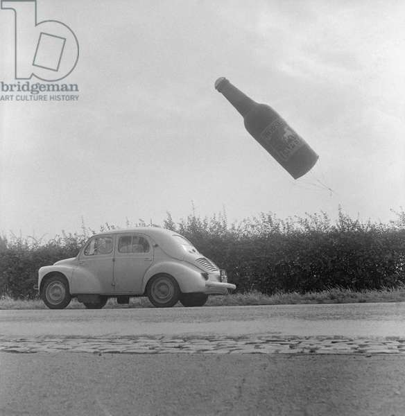 A flying beer bottle, advertisemnt for a brewery near Ypres in Belgium, August 22, 1960 (b/w photo)