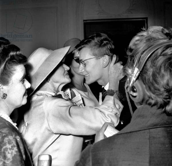 French Dress Designer Yves Saint Laurent Congratulated By Marguerite Carre, One of Dior Manager, After Presentation of Winter Collection By Yves Saint Laurent, Paris, July 31, 1958 (b/w photo)