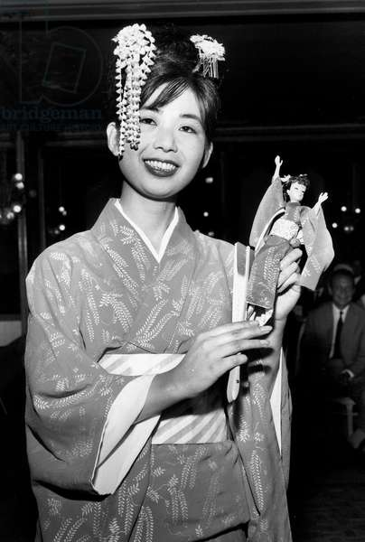 Model Presenting Japonese Barbie Doll in Paris May 14, 1964 (b/w photo)