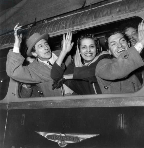 Jean Cocteau, Andree Debar and Jean Marais in Train February 6, 1949 : They Are Going at Orly Airport (For A Tour in Middle East) (b/w photo)