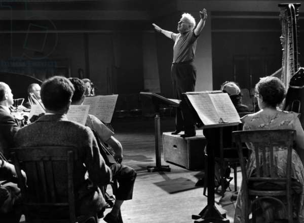 Charlie Chaplin recording the score of the film A King  in New York, at the Maison de la Mutualite, Paris, France, June 21, 1957