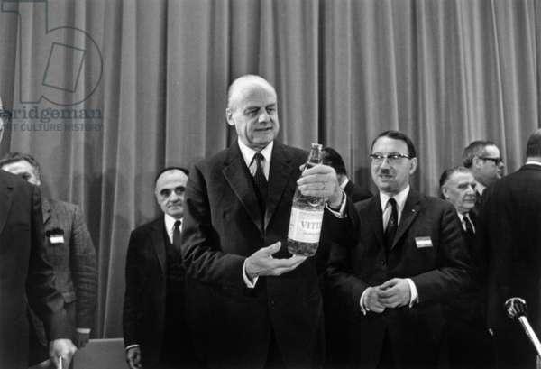 Arnaud De Vogue Presents New Plastic Bottle at Saint Gobain's Headquarters January 16, 1969 (b/w photo)
