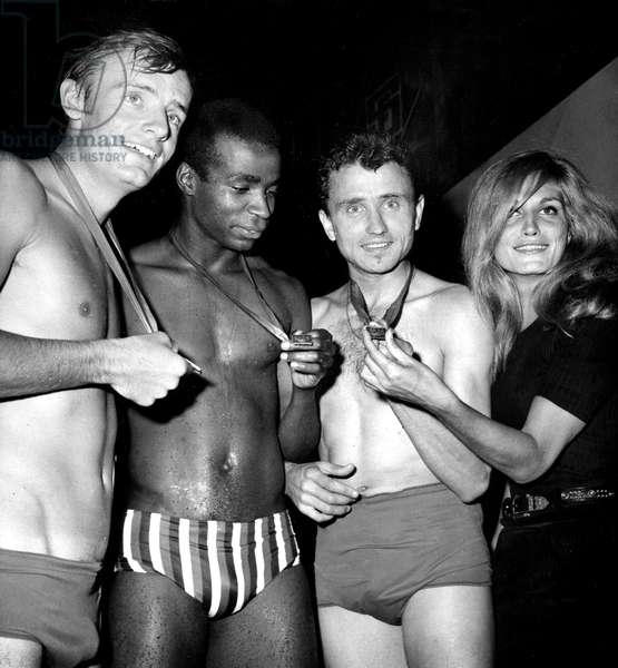 Sportsmen Jean-Claude Killy Roger Bambuck and Michel Jazy Congratulated By Singer Dalida After 33 Meters Swimming Race For New Radioprogram October 3, 1966 (b/w photo)