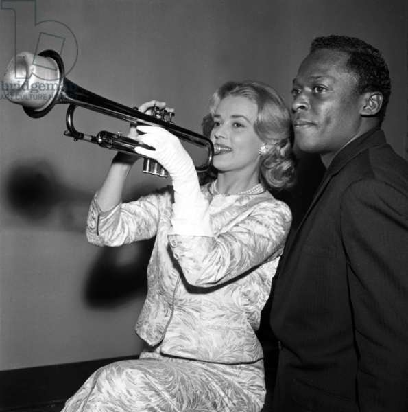 """Jeanne Moreau and Miles Davis during Recording of The Music of Film """"Elevator To The Gallows """" on December 5, 1957 (b/w photo)"""