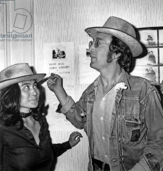 John Lennon and Yoko Ono at Cannes Festival May 18, 1971 (b/w photo)