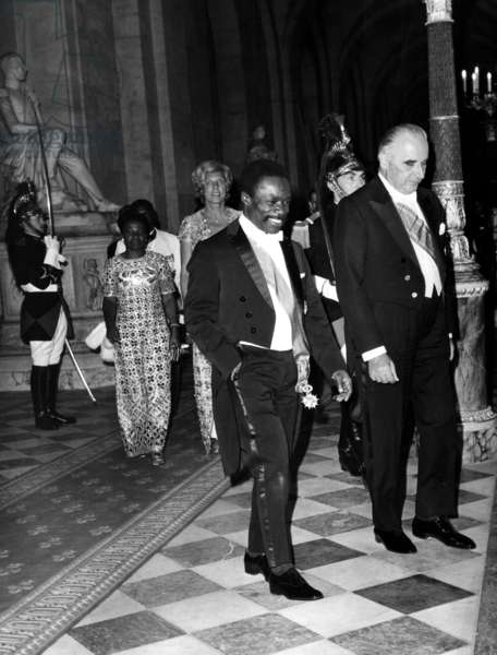 Omar Bongo, President of Gabon, and French President Georges Pompidou in Versailles on July 7, 1970 (Behind : Their Wives) (b/w photo)
