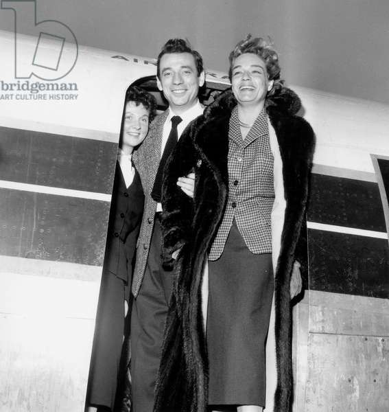 Yves Montand and Simone Signoret Leaving Paris By Plane For Moscow, December 16, 1956 (b/w photo)