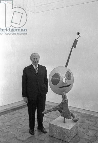 Joan Miro posing with one of his sculptures at the Maeght Foundation in Saint Paul de Vence during his work exhibition on April 17, 1973