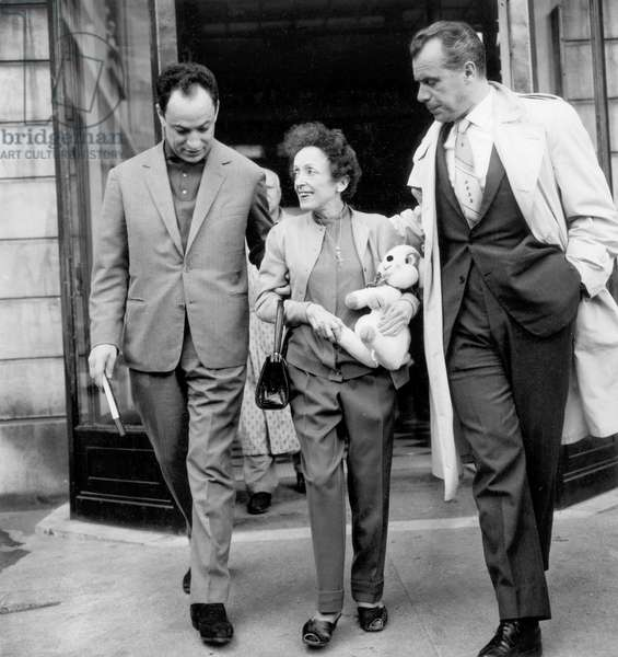 French Singer Edith Piaf Leaving Hospital With Charles Dumont and Louis Barrier June 8, 1961 (b/w photo)