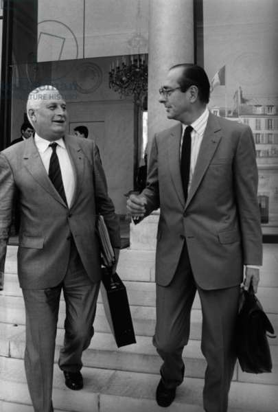 Andre Giraud, Minister of Defense and Jacques Chirac, Prime Minister, leave L'Elysee at the end of the Council of Ministers. October 8, 1986 (photo)