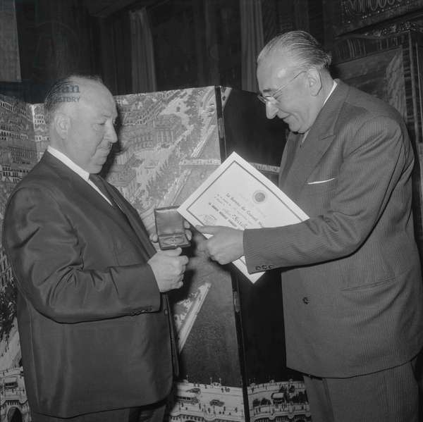 Alfred Hitchcock receiving the City of Paris medal from Mr Tardieu, October 4, 1960 (b/w photo)