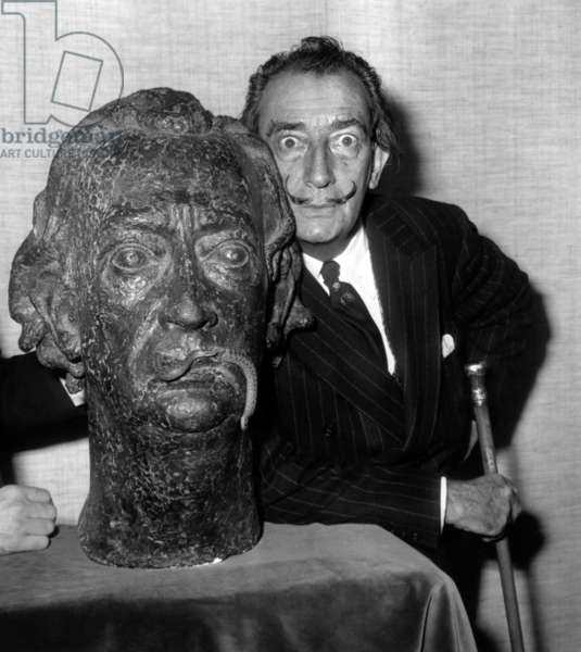 Salvador Dali With his Bust By Georges Boulogne, at Falvart Gallery, November 13, 1963 (b/w photo)