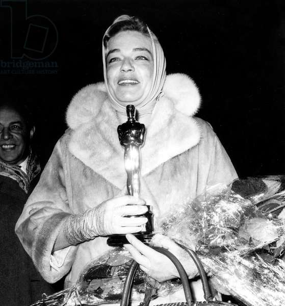 Simone Signoret receiving Best Actress at the Academy Awards For 'Room at The Top' on April 11, 1960 (b/w photo)