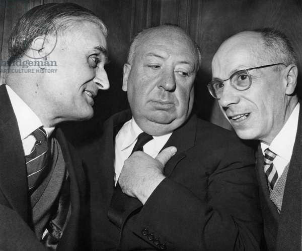"""Writers Thomas Narcejac and Pierre Boileau (Right) with Alfred Hitchcock who adapted their novel """"Between the Dead"""" for his 1958 film Vertigo,  March 23, 1971"""
