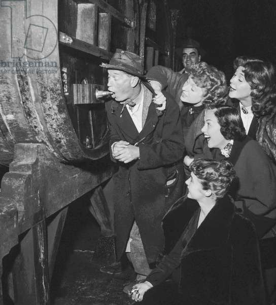 "Maurice Chevalier, Patachou, Sophie Desmarets, Roberta and Vera Norman at presentation of film Ma pomme"" in Epernay, France, October 9, 1950 (b/w photo)"