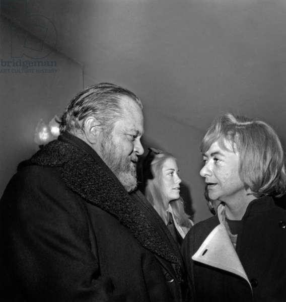Orson Welles Congratulated By Francoise Sagan Because Film The Trial (1963) Is Re-Released on Feburary 16, 1973 (b/w photo)