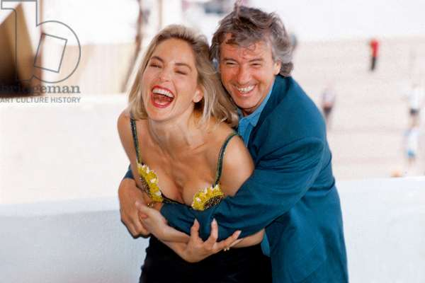 """Director Paul Verhoeven and Sharon Stone at Cannes Film Festival For Film """"Basic Instinct"""" May 11, 1992 (photo)"""