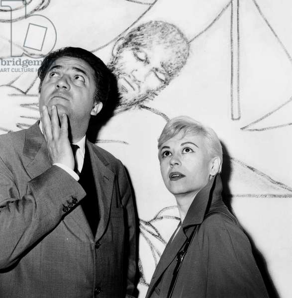 Federico Fellini and Giulietta Masina Visiting The Chapel Decorated By Jean Cocteau May 13, 1957 in Villefranche Sur Mer (France) during Cannes Film Festival