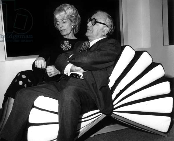 """Mrs. Herve Alphand And Marcel Achard Try The New Armchair Cree By Cardin Call """"Le Mille-Feuilles"""" December 2, 1970 (b/w photo)"""
