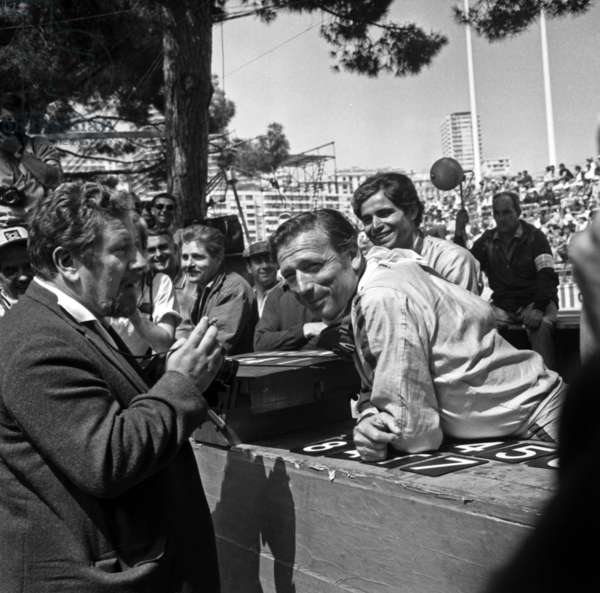 """At Time of Filming of Film """"Grand Prix"""" By Johnfrankeiheimer : Yves Montand Speaking With Peter Ustinov at The Grand Prix of Monaco on May 23, 1966 (b/w photo)"""