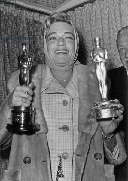 Simone Signoret With her Golden Oscar Given By Hollywood and A Plaster Oscar Given By The Press, April 11, 1960 (b/w photo)