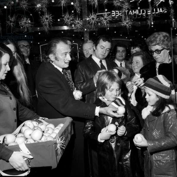 Salvador Dali Distributing Apples To Children at Paramount Elysees, Paris, December 26, 1970 (b/w photo)
