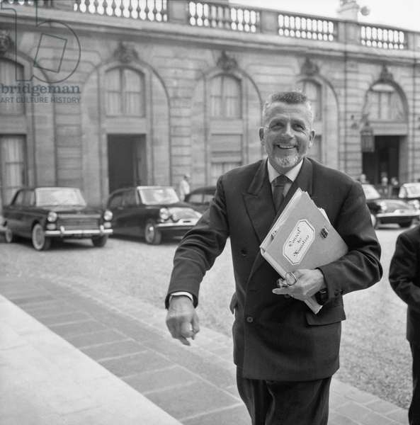 French minister Robert Buron arriving at the Elysee, Paris, to attend the council of ministers, August 24, 1960 (b/w photo)
