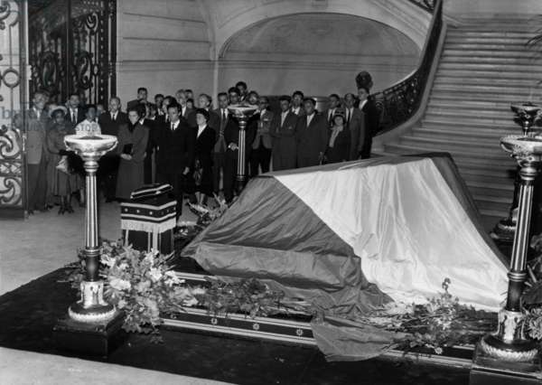 The children of Frederic Joliot-Curie, Pierre and Helene,  in front of his coffin at the Sorbonne University in Paris, August 16, 1958 (b/w photo)