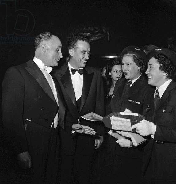 "Screening of film ""Gone en Awporte l'histoire"" Palais en Chaillot, Paris, December 10, 1949: Paul Boncoeur, Vera Korene, Pierre Bloch, Henri Teitgen (b/w photo)"