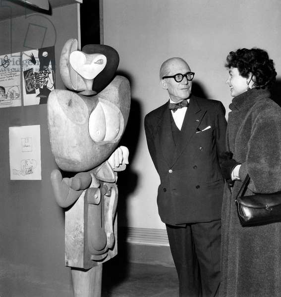 Architect Le Corbusier (1887-1965) at Exhibition of his Work here in Front of Sculpture Woman November 17, 1953 (b/w photo)