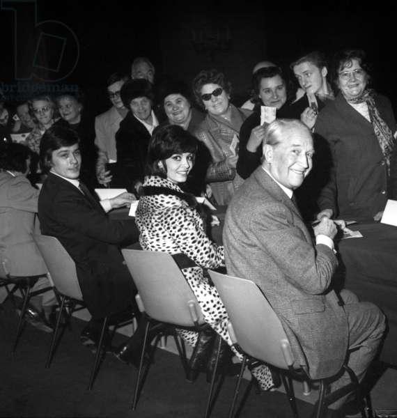 Alain Delon, Michele Mercier and Maurice Chevalier Dedicating Cards in Paris City Hall, December 10, 1970 (b/w photo)