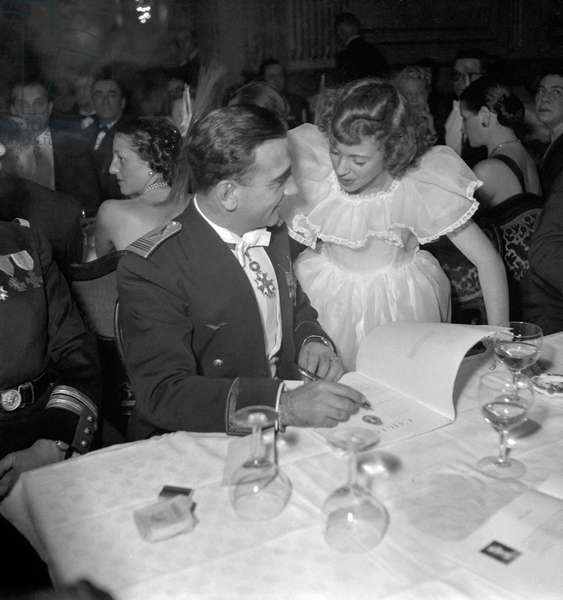 The Night of the Wings, Palais d'Orsay, Paris, December 10, 1949 : French colonel Pouyade and actress Lucie Valnor (b/w photo)