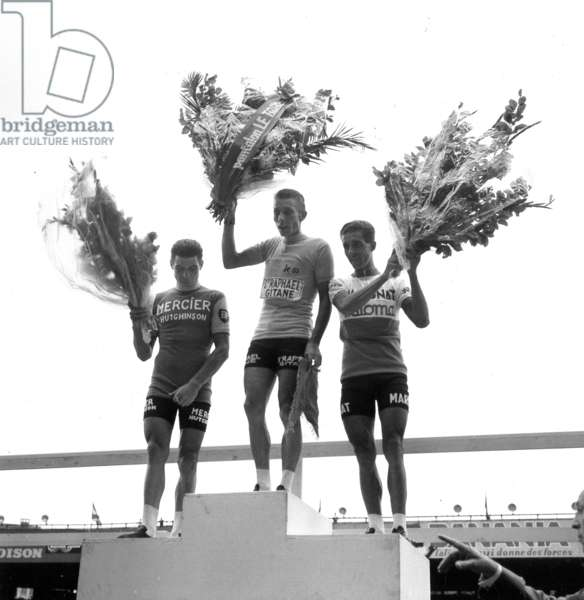 Arrival of Tour De France at The Parc Des Princes in Paris on July 14, 1964 : The Podium : Raymond Poulidor, Jacques Anquetil (Winner) and Federico Bahamontes (b/w photo)