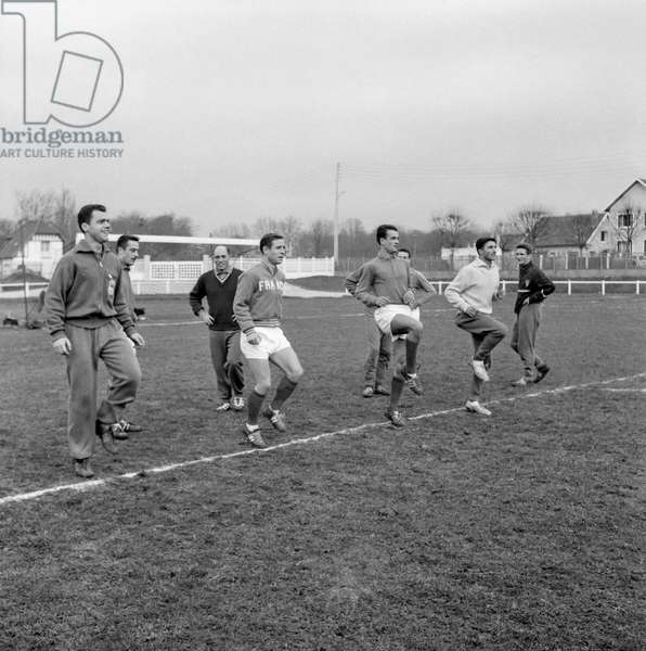 French football team during a training in Reuil on December 9, 1959 : Raymond Kopa, Guy Senac, Georges Lamia (b/w photo)
