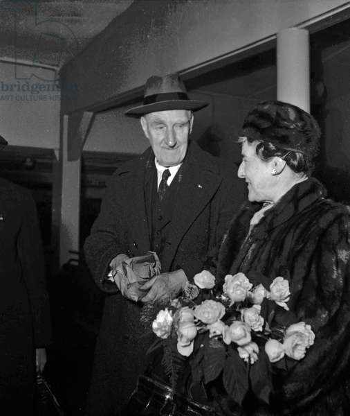 Lord Boyd Orr, Peace Nobel Prize, arriving at Bourget airport, Paris with his wife, December 15, 1949 (b/w photo)