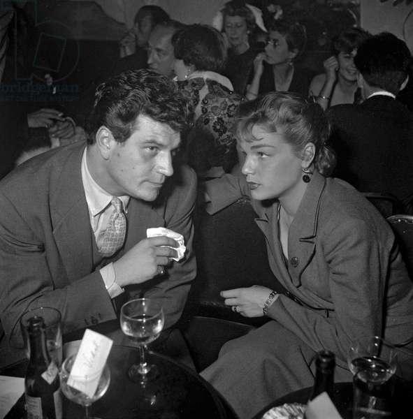 French actors Henri Vidal and Simone Signoret at restaurant