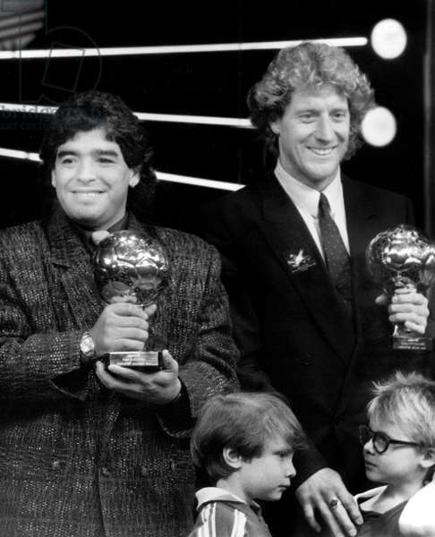 Footballers Maradona (Argentina) on The Left and Harald Schumacher (Frg) Receiving Respectively The Gold Balloon and the Silver Balloon of The Soccer World Cup November 13, 1986 during Party at The Lido in Paris (b/w photo)